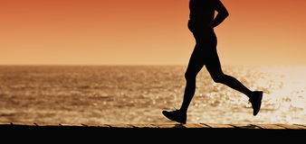 Silhouette of sport active man running Stock Images