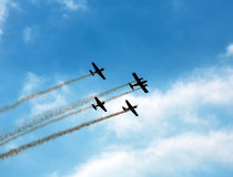 Silhouette sport aircraft in air show Stock Images