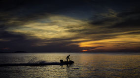 Silhouette of sportsman with jet ski at sea Stock Photography
