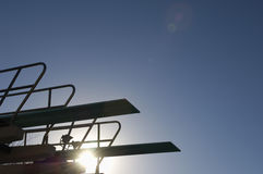Silhouette Of A Springboard At Sunset Stock Photo