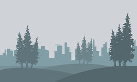 Silhouette of spruce and city in fog Royalty Free Stock Photography