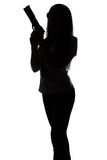 Silhouette of spy woman with gun. On white background stock images