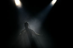 Silhouette at the stage. Silhouette of the man at dark the stage Royalty Free Stock Photography