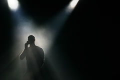 Silhouette at the stage. Silhouette of the man at dark the stage Royalty Free Stock Images