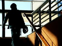Silhouette on staircase. Man on a climbing staircase royalty free stock images