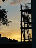 Silhouette of the stairs at sunset stock images