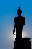 Silhouette of standing big Buddha statue during twilight time Stock Images