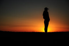 Silhouette of standing girl Stock Photos