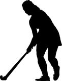 Silhouette of standing girl hockey player prepare  Royalty Free Stock Image