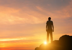 Silhouette of a standing man at colorful sunset in summer Royalty Free Stock Photo