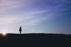 Silhouette of Standing Person Stock Photography