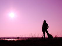 Silhouette of standing woman. Silhouette of woman stretching on the sun Stock Photos