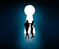 Silhouette stands near big keyhole exit. Stock Photography