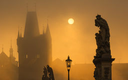 Silhouette of statue on Charles bridge during sunrise Royalty Free Stock Images