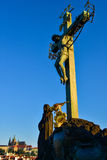A silhouette of the statue of Christ on the cross on Charles Bridge at sunset in Prague Royalty Free Stock Image