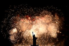 Silhouette statue of liberty on firework background.  stock images