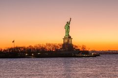 The silhouette of Statue of Liberty in New York City Royalty Free Stock Photos