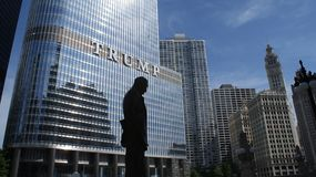 Silhouette of Statue Near Trump Building at Daytime Stock Photos