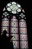 Silhouette of statue praying in the window of the cathedral. Of Notre Dame Stock Photos