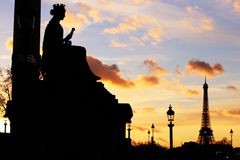 Eiffel tower and Concorde square statue silhouettes at sunset. Silhouette of the statue representing the city of MARSEILLES, Place de la Concorde, Paris. The stock photo