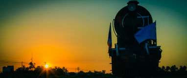 Silhouette steam locomotive at sunset in Thailand. Vintage tone Stock Image