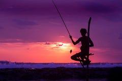 Silhouette of stilt fisherman at sunset in Koggala, Sri Lanka. Silhouette of traditional stilt fisherman at sunset on beach in Koggala, Sri Lanka royalty free stock photography