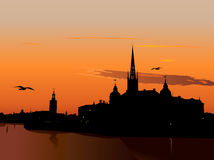Silhouette of Stockholm at sunset. The City Hall, Riddarholm cathedral. Sweden Stock Photos