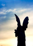 Silhouette of a Stone Angel at Sunset Stock Photography
