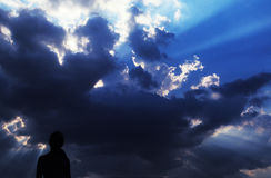 Silhouette  on a stormy sky Stock Images