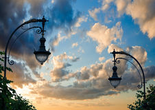 Silhouette of a street lamp on the background of the beautiful s Stock Image