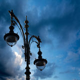 Silhouette of a street lamp on the background of the beautiful s Royalty Free Stock Images
