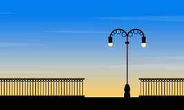 Silhouette of street lamp at sunset landscape. Vector art vector illustration