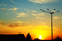 Silhouette of streetlamp against backlight on sunset background Stock Photography