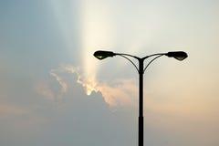 Silhouette of streetlight with beautiful sunbeam Royalty Free Stock Photos