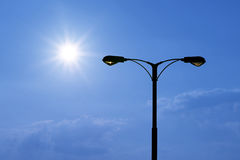 Silhouette of streetlight with beautiful sunlight Stock Images