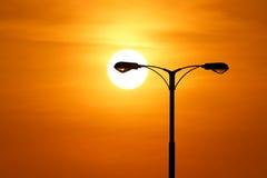 Silhouette of streetlight with beautiful sunset Stock Photo
