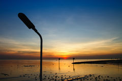 Silhouette of streetlight with beautiful sunset twilight sky at Royalty Free Stock Photos
