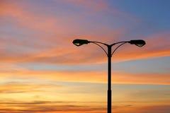 Silhouette of streetlight with beautiful twilight Stock Photo