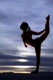 Silhouette stretch leg up Stock Photos