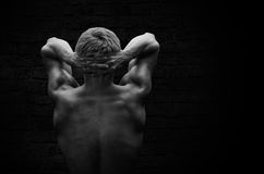 Silhouette of a strong, athletic man royalty free stock photo