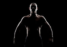 Silhouette of a strong man Stock Image
