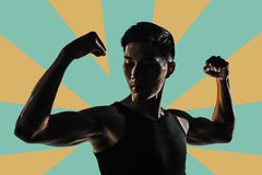 Silhouette of strong man Stock Photography