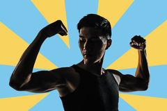 Silhouette of strong man Stock Photo