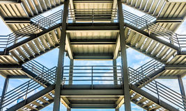 The silhouette of structure of iron stairway Stock Photos