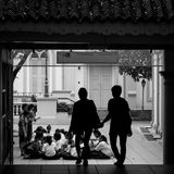 Silhouette of Students at Asian School. A Silhouette of two students walking to the school at CHJIMES in Singapore Stock Photography