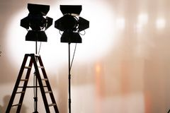 Studio lighting equipment. The silhouette of studio lighting equipment behind silk frame royalty free stock image