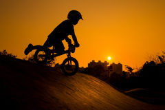 Silhouette Of Stunt Bmx Child Rider. Color tone tuned Stock Images