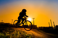 Silhouette Of Stunt Bmx Rider. Color tone tuned Stock Photography