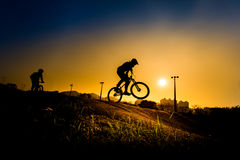 Silhouette Of Stunt Bmx Rider Stock Photos
