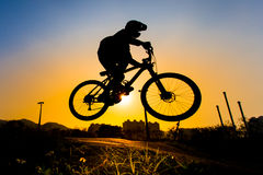 Silhouette Of Stunt Bmx Rider. Color tone tuned Stock Photo